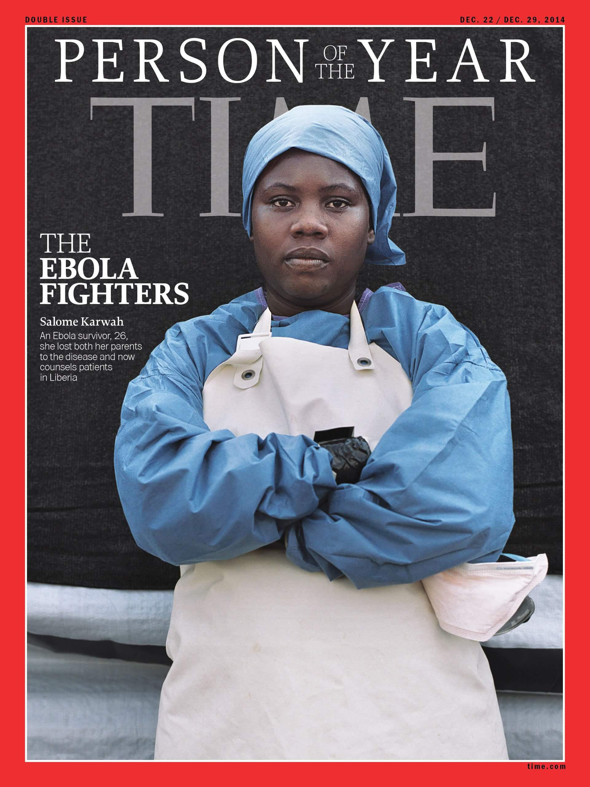 Female Health Worker in Uniform Poses with Arms Crossed