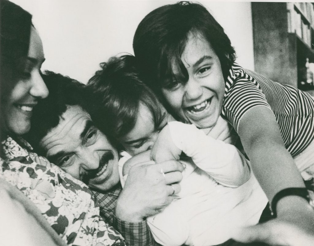 Family of Four Playing, Squeezed Close Together