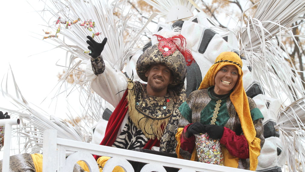 Two Costumed Persons Throwing Candy During Parade