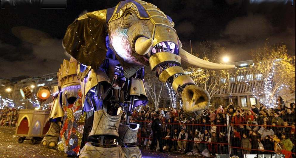 Lighted Elephant Float During Parade at Night