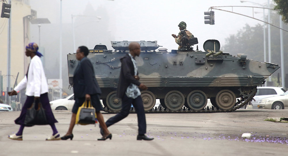 People Walking Across Street with Tank and Soldier in Background